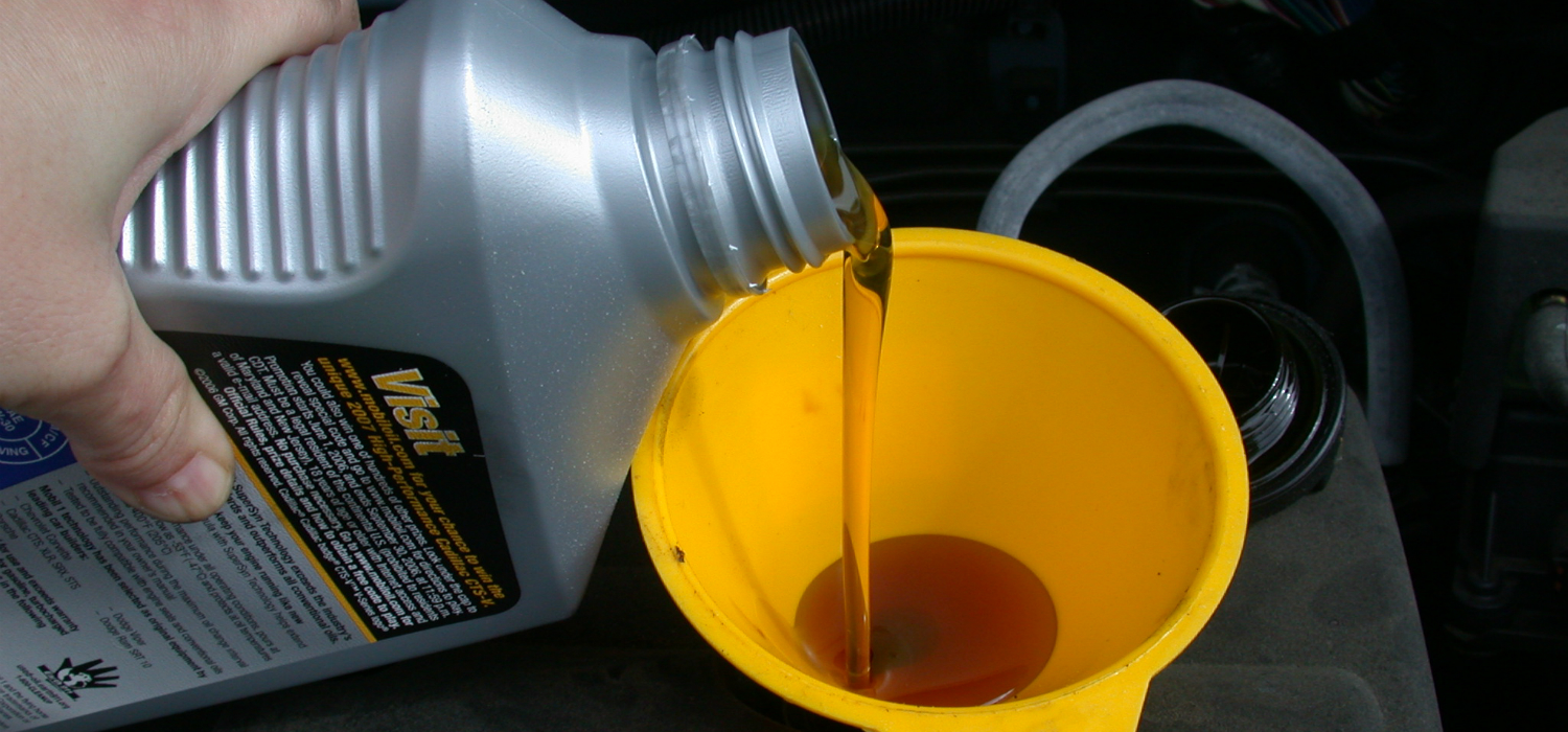 Motor_oil_refill_with_funnel.jpg