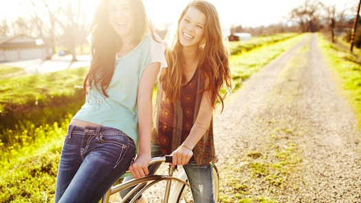 girls on a bike in the sunshine